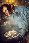 Kiwi dog handler, prepares seal meat for huskies, Scott Base, Ross island, Antarctica