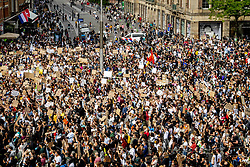People take part in a Black Lives Matter protest on Dam Square in Amsterdam, Netherlands on June 1, 2020, to protest against the recent killing of George Floyd, a black man who died in police custody in Minneapolis, U.S.A., after being restrained by police officers on Memorial Day. Photo by Robin Utrecht/ABACAPRESS.COM  George Foule Crowd Gathering Rally Protest Manifestation Rassemblement Manif Manifestations Rassemblements Demonstration Racisme Racism Black Lives Matter BLM    732370_002 Amsterdam Pays-Bas Netherlands