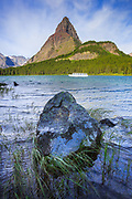 Tourists take in sights on a tour across Swiftcurrent Lake, Glacier National Park.
