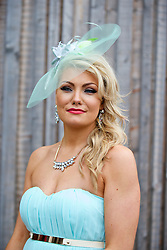 LIVERPOOL, ENGLAND - Friday, April 4, 2014: Claire Taylor of Manchester wearing Misguided during Ladies' Day on Day Two of the Aintree Grand National Festival at Aintree Racecourse. (Pic by David Rawcliffe/Propaganda)