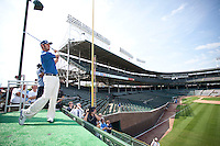 Dustin Johnson hits wedges at Wrigley Field as part of the BMW Open being held in Chicago.