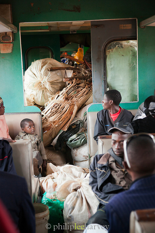 People transport goods to sell on the Kenyan Railways train from Mombasa to Nairobi, dubbed the Lunatic Express