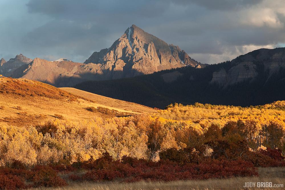 Sunset light shines thru storms clouds onto Mount Sneffels 14,150ft, Colorado.