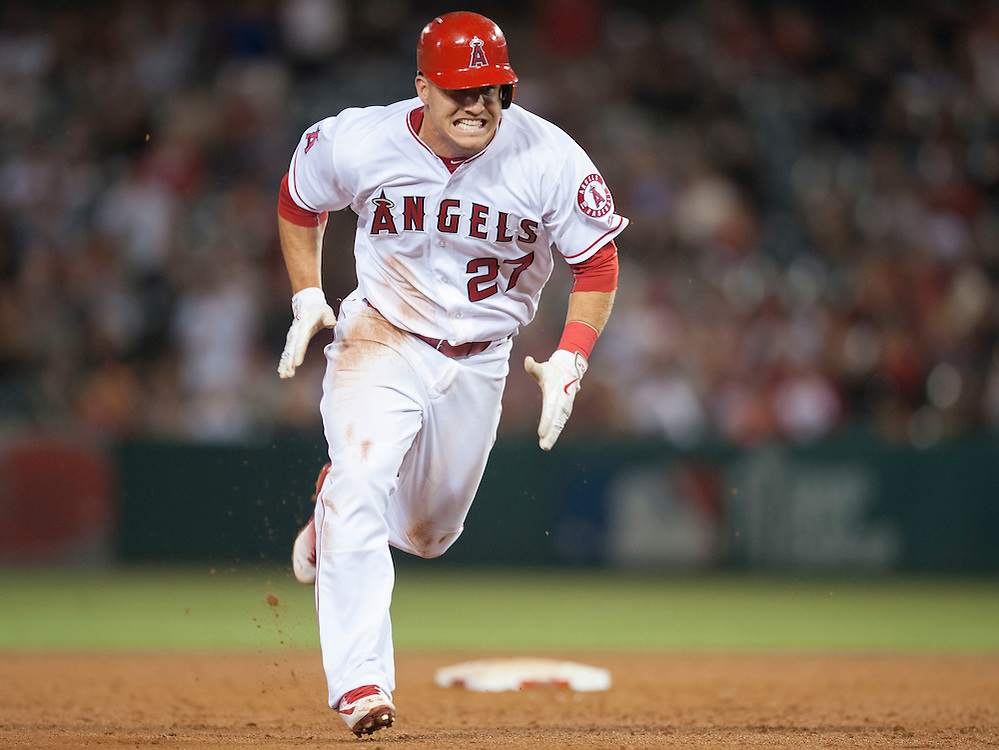 The Angels Mike Trout heads home on an error by the Cardinals Stephen Piscotty during the fifth inning against the St. Louis Cardinals Thursday at Angel Stadium.<br /> <br /> ADDITIONAL INFO:   <br /> <br /> angels.0405.kjs  ---  Photo by KEVIN SULLIVAN / Orange County Register  -- 5/12/16<br /> <br /> The Los Angeles Angels take on the St. Louis Cardinals Thursday at Angel Stadium.