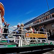 Three weeks aboard the Kong Harald. Hurtigruten, the Coastal Express. Passengers leaving the ship in Sandnessjoen.