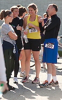 Hallie McNamara, Rachel Willcutt, Hannah Willcutt and Mark Prout enjoy a laugh at the Laconia Athletic and Swim Club following the 5k run of the WOW Fest Saturday morning.  (Karen Bobotas/for the Laconia Daily Sun)
