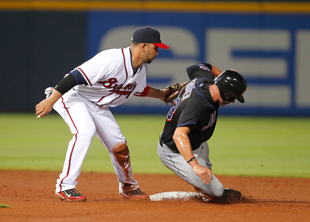 ATLANTA - AUGUST 3:  Outfielder Chris Carter #23 of the New York Mets is tagged out on a stolen base attempt by shortstop Alex Gonzalez #2 of the Atlanta Braves during the game at Turner Field on August 3, 2010 in Atlanta, Georgia.  The Mets beat the Braves 3-2.  (Photo by Mike Zarrilli/Getty Images)