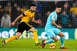 Ayoze Perez of Newcastle United takes on Ruben Neves of Wolverhampton Wanderers - Mandatory by-line: Robbie Stephenson/JMP - 11/02/2019 - FOOTBALL - Molineux - Wolverhampton, England - Wolverhampton Wanderers v Newcastle United - Premier League