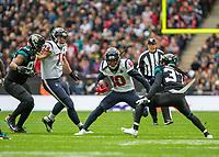 American Football - 2019 NFL Season (NFL International Series, London Games) - Houston Texans vs. Jacksonville Jaguars<br /> <br /> DeAndre Hopkins, Wide Receiver, (Houston Texans) checks his run as he tries to go around Tre Herndon, Cornerback, (Jacksonville Jaguars) at Wembley Stadium.<br /> <br /> COLORSPORT/DANIEL BEARHAM