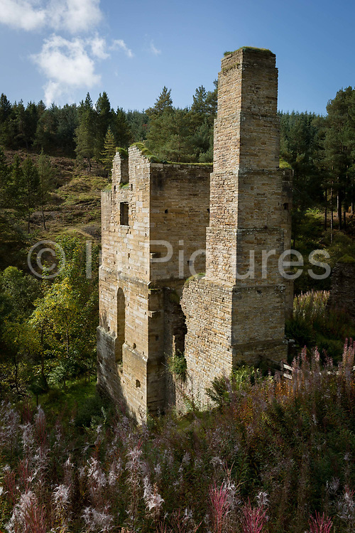 A exterior of the now ruined Shildon Engine House, on 29th September 2017, in Blanchland, Northumberland, England. Built around 1805 to house a Cornish pumping engine which kept the network of lead mines operating underneath from flooding. The North Pennines is known for its deposits of lead ore etc., a large part of the areas economy. In the 1840s an enormous steam engine was installed in an attempt to keep the mines dry enough to work. Following decommissioning, the engine house was converted to a series of flats for mining families. It was finally abandoned around 100 years ago and has been derelict ever since. The Engine House is a dramatic reminder of a once thriving lead mining community of 170 people. The population declined after the mid-1800s when cheaper lead began to be imported from abroad, and young Shildon families emigrated to the goldmining areas of Australia and America.