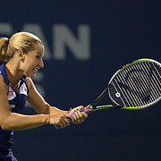 August 16, 2014, New Haven, CT:<br /> Dominika Cibulkova hits a forehand during a match against Andrea Pekovic on day four of the 2014 Connecticut Open at the Yale University Tennis Center in New Haven, Connecticut Monday, August 18, 2014.<br /> (Photo by Billie Weiss/Connecticut Open)