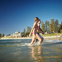Couple at Cottesloe Main Beach with Indiana Tearooms in the background
