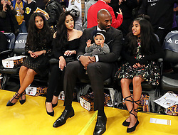 December 18, 2017 - Los Angeles, California, U.S - The retirement of the Los Angeles Lakers player, Kobe Bryant's #8 and #24 jerseys was held Monday December 18, 2017 in Los Angeles, California during half time of the game between with the Golden State Warriors. Kobe Bryant with his family (L-R) Gianna Maria-Onore, wife, Vanessa Laine Bryant, Kobe Bryant holding Bianka Bella and Natalia Diamante. (Credit Image: © Prensa Internacional via ZUMA Wire)