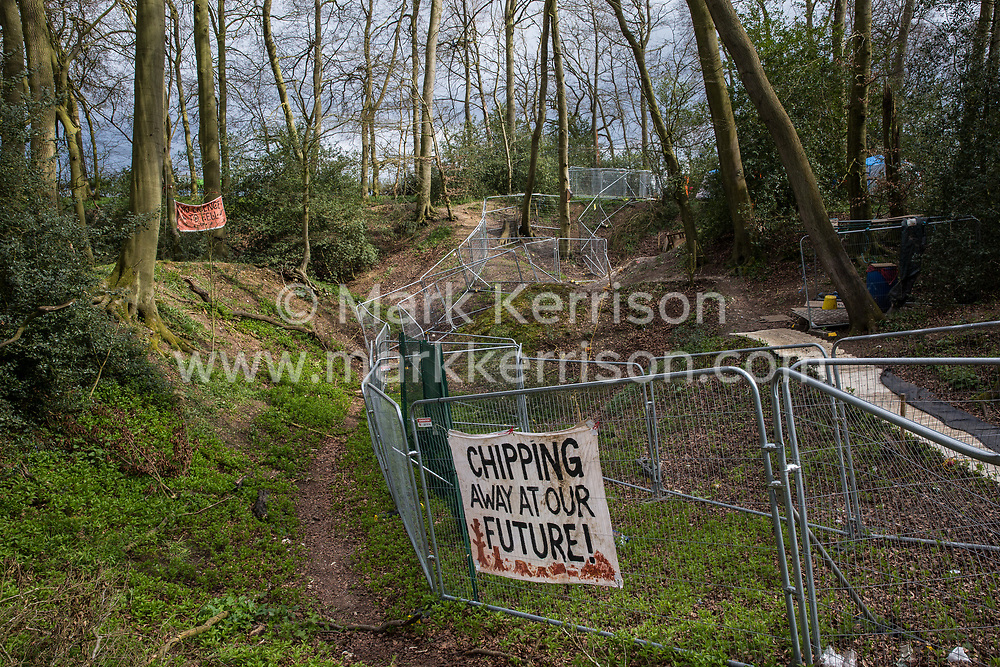 A banner hung on fencing by environmental activists is pictured during tree felling operations for the HS2 high-speed rail link in Jones Hill Wood, ancient woodland said to have inspired Roald Dahl, on 9th April 2021 in Wendover, United Kingdom. Tree felling work began this week, in spite of the presence of resting places and/or breeding sites for pipistrelle, barbastelle, noctule, brown long-eared and natterer's bats, following the issue by Natural England of a bat licence to HS2's contractors on 30th March.