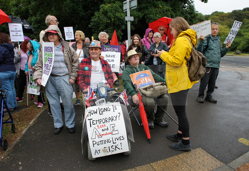 © Licensed to London News Pictures.  04/07/2017; Weston-super-Mare, North Somerset, UK. A protest against the overnight closure of Weston General Hospital Accident and Emergency department is held before the Weston Area Health NHS Trust  Board meeting at Weston General Hospital which is to agree the temporary overnight closure of the Accident & Emergency department because of staffing levels, with no projected date given for a return to 24hr service. It was announced last month the A&E unit would be closing between 10pm and 8am from Tuesday 04 July, after a Care Quality Commission inspection raised concerns over the long-term sustainability of staffing levels. The decision has been made on patient safety grounds because the trust cannot provide enough specialist hospital doctors to safely staff the A&E department overnight. Patients arriving by ambulance will instead be taken to either the BRI or Southmead in Bristol, or Taunton's Musgrove Park hospitals, and anyone who would otherwise turn up to the A&E department themselves is being urged to either try to get to Bristol or ring the NHS helpline on 111. Unison, the trade union representing health workers, said it was vital the NHS bosses running Weston's hospital had a plan in place to reinstate the 24 hour service as soon as possible, so the temporary closure didn't become permanent. Unison says the closure comes from a staffing shortage that is the direct result of the government running down the NHS, and that on the week of the NHS' 69th birthday, they value this national treasure and the staff who keep it going more than ever. A hospital spokesman said they had no choice to close the unit after the CQC report rated the A&E department 'inadequate', and that A&E has been fragile for several years as a result of ongoing challenges around medical recruitment and a national shortage of A&E doctors which has made this position worse. They have become heavily reliant on locum and agency workers and the risk