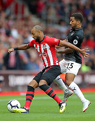"""Southampton's Nathan Redmond (left) and Burnley's Aaron Lennon battle for the ball during the Premier League match at St Mary's, Southampton. PRESS ASSOCIATION Photo. Picture date: Sunday August 12, 2018. See PA story SOCCER Southampton. Photo credit should read: Andrew Matthews/PA Wire. RESTRICTIONS: EDITORIAL USE ONLY No use with unauthorised audio, video, data, fixture lists, club/league logos or """"live"""" services. Online in-match use limited to 120 images, no video emulation. No use in betting, games or single club/league/player publications."""