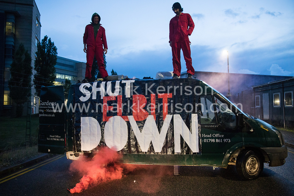 Sandwich, UK. 4th October, 2021. Palestine Action activists watch a smoke grenade from the roof of a van used to block an entrance to the Instro Precision factory in Discovery Park. Instro Precision is a subsidiary of Elbit Systems, Israel's largest publicly-traded arms company which markets drones used extensively by the Israeli military in Gaza as 'battle-proven', and it supplies 'high precision military equipment'. Palestine Action contends that equipment sold by Instro Precision has been used by the Israeli military against the civilian population of Gaza.