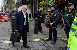 © Licensed to London News Pictures. 23/03/2017. London, UK. Labour party leader JEREMY CORBYN seen passing armed police as he arrives at the Houses of Parliament, the day after a lone terrorist killed 4 people and injured several more, in an attack using a car and a knife. The attacker managed to gain entry to the grounds of the Houses of Parliament, killing one police officer. Photo credit: Ben Cawthra/LNP