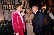 Theo Fennell, Sir Donald Gosling and Gaby Dinora,  Hot Ice party hosted by Dominique Heriard Dubreuil and Theo Fennell, ( Remy Martin and theo Fennell) at 35 Belgrave Sq. London W1. 26 October 2004. ONE TIME USE ONLY - DO NOT ARCHIVE  © Copyright Photograph by Dafydd Jones 66 Stockwell Park Rd. London SW9 0DA Tel 020 7733 0108 www.dafjones.com