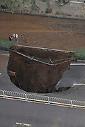 XI'AN, CHINA - OCTOBER 27:  China Out - Finland Out<br /> <br /> Large Sinkhole <br /> <br /> People look at a large sinkhole on a street after a water pipe broke underneath it on October 27, 2013 in Xi'an, Shaanxi province of China. According to local media, the pipe was damaged due to ageing and no casualty was reported in the incident. <br /> ©Exclusivepix