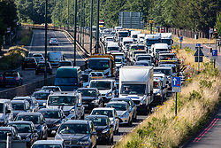 © Licensed to London News Pictures. 15/06/2020. London, UK. Heavy traffic on the A3 in to London as non essential shops are given the green light to open in England after 3 months of being closed due to the coronavirus pandemic. Commuters have also been told to wear masks from Monday while travelling on Public Transport. Photo credit: Alex Lentati/LNP