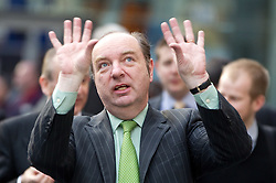 © licensed to London News Pictures. Manchester, UK  27/03/2012. Norman Baker, MP for Lewes and Parliamentary Under Secretary for the Department for Transport, at the launch of the Brompton cycle hire scheme at Manchester Piccadilly Railway Station. Photo credit should read Joel Goodman/LNP