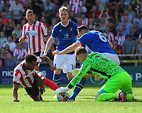Lincoln City's Matt Green vies for possession with Carlisle United's Jack Bonham<br /> <br /> Photographer Chris Vaughan/CameraSport<br /> <br /> The EFL Sky Bet League Two - Lincoln City v Carlisle United - Saturday 26th August 2017 - Sincil Bank - Lincoln<br /> <br /> World Copyright © 2017 CameraSport. All rights reserved. 43 Linden Ave. Countesthorpe. Leicester. England. LE8 5PG - Tel: +44 (0) 116 277 4147 - admin@camerasport.com - www.camerasport.com