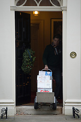 © London News Pictures. 12/12/2012. London, UK.   Wine, wine glasses and diet coke - Trolley number four of five containing alcoholic drinks and glasses being delivered to 11 Downing Street by Majestic wines on December 12, 2012. Photo credit: Ben Cawthra/LNP