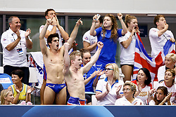 Jack Laugher and Chris Mears lead the Great Britain team in celebration as Sarah Barrow (not pictured) nails her final dive to win the Womens 10m Platform Final - Photo mandatory by-line: Rogan Thomson/JMP - 07966 386802 - 22/08/2014 - SPORT - DIVING - Berlin, Germany - SSE im Europa-Sportpark - 32nd LEN European Swimming Championships 2014 - Day 10.