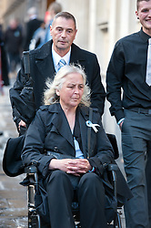 © Licensed to London News Pictures. 13/11/2015. Bristol, UK.  DARREN GALSWORTHY the father of murder victim Rebecca Watts, wheels his wife ANJIE GALSWORTHY, the mother of Nathan Matthews who was convicted of Becky Watts' murder, back to Bristol Crown court to hear Nathan Matthews, the son of Anjie, sentenced to a minimum of 33 years for the murder of Darren's daughter Rebecca Watts.  Photo credit : Simon Chapman/LNP