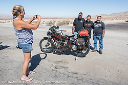 Melissa Shoemaker takes a photo of Anthony Rutledge, Cris Simmons and Dave Minerva at a stop during the Motorcycle Cannonball Race of the Century. Stage-14 ride from Lake Havasu CIty, AZ to Palm Desert, CA. USA. Saturday September 24, 2016. Photography ©2016 Michael Lichter.