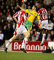 Photo: Paul Greenwood/Sportsbeat Images.<br />Stoke City v Norwich City. Coca Cola Championship. 01/12/2007.<br />Norwich's Ched Evans (C) beats  Stoke's Leon Cort in the air