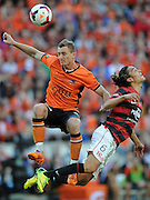 BRISBANE, AUSTRALIA - MAY 04: BesartÊBerishaÊofÊtheÊRoar heads the ball towards the goal over JeromeÊPolenzÊofÊtheÊWanderers during the 2014 A-League Grand Final match between the Brisbane Roar and the Western Sydney Wanderers at Suncorp Stadium on May 4, 2014 in Brisbane, Australia.  (Photo by Matt Roberts/Getty Images)