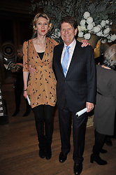 SIR JOHN MADEJSKI and his daughter HELEN MORRIS at a private view of the Royal Academy's Modern British Sculpture exhibition held at Burlington House, Piccadilly, London on 18th January 2011.