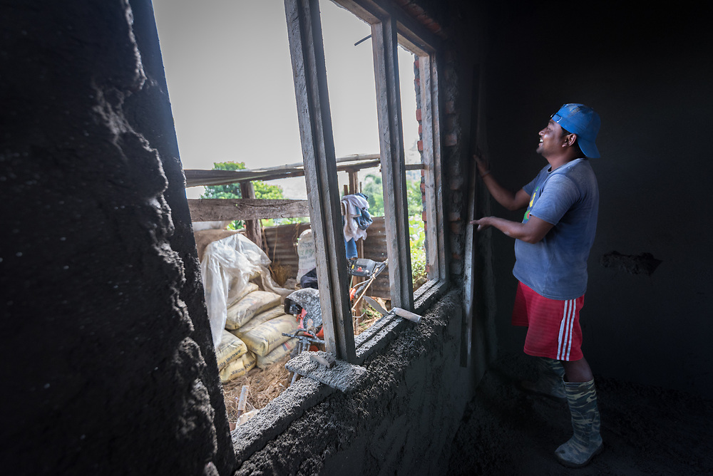 17 September 2018, Kavre district, Nepal: Broma Chao Devi works on the reconstruction of a house after the 2015 earthquake caused all the buildings in the Maidan village to collapse. The Lutheran World Federation World Service programme runs a Post-Earthquake Rehabilitation and Livelihood Recovery Project in Kavre district, through which technical support and advice is given to community members so that they can build earthquake-resilient. constructions.
