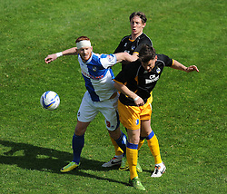 Bristol Rovers' Matt Harrold battles for the ball with Mansfield Town's James Jennings - Photo mandatory by-line: Alex James/JMP - Mobile: 07966 386802 03/05/2014 - SPORT - FOOTBALL - Bristol - Memorial Stadium - Bristol Rovers v Mansfield - Sky Bet League Two