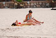 Israel, Tel Aviv, woman sunbathing on the beach