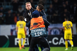 February 14, 2019 - MalmÃ, Sweden - 190214 Physio Jesper Robertsson and security personel handles a pitch invader during the Europa league match between Malmö FF and Chelsea on February 14, 2019 in Malmö..Photo: Ludvig Thunman / BILDBYRÃ…N / kod LT / 92225 (Credit Image: © Ludvig Thunman/Bildbyran via ZUMA Press)