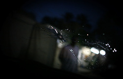 A cracked windshield bears witness to the assassination of an Shiia man and his three daughters by Sunni insurgents on Monday April 23, 2007