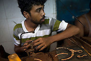 18 hours of work and 6 hours of sleep in one of the workshops for the Indian diamond industry. The low light makes the diamonds more visible.