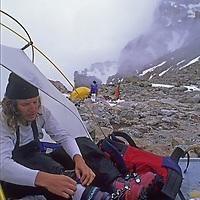 MOUNTAINEERING, Grand Teton National Park, Wyoming, Peter Spricenieks at Lower Saddle camp below Grand Teton.
