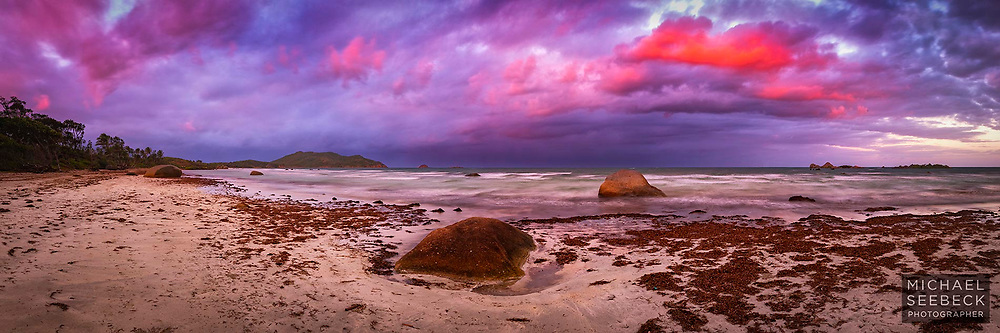 Low scudding cumulus clouds suddenly light up with pink and orange colours at sunset on Chilli Beach.<br /> <br /> Limited Edition of 125 Prints