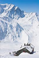 The Valsorey Hut overlooks grand views of Mont Velan in the Swiss Alps.