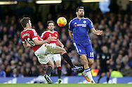 Diego Costa of Chelsea and Daley Blind of Manchester United compete for the ball. Barclays Premier league match, Chelsea v Manchester Utd at Stamford Bridge in London on Sunday 7th February 2016.<br /> pic by John Patrick Fletcher, Andrew Orchard sports photography.