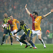 Galatasaray's Servet CETIN (R) and Fenerbahce's Mamadou NIANG (C) during their Turkish superleague soccer derby match Galatasaray between Fenerbahce at the Turk Telekom Arena in Istanbul Turkey on Friday, 18 March 2011. Photo by TURKPIX