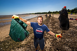 15JUL21 Matt helping out. The Marine Conservation Society launching it's big beach clean up volunteer call at Cramond beach this morning.
