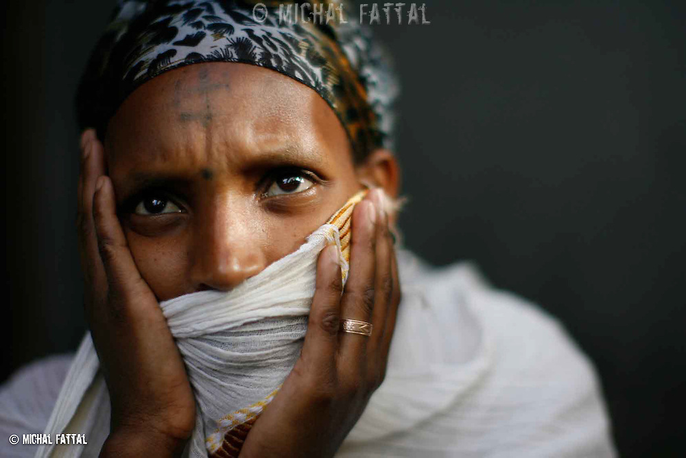 An Ethiopian woman, a few hours before she leaves the Jewish agency compund in Addis Ababa to the airport, in order immigrate to Israel