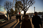 Autumn scene with sun setting on the Southbank riverside walkway, London, United Kingdom. The South Bank is a significant arts and entertainment district, and home to an endless list of activities for Londoners, visitors and tourists alike.