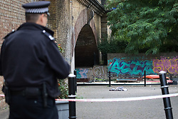 © Licensed to London News Pictures. 22/09/2018. London, UK.  A police officer at the scene in Island Row in Limehouse, Tower Hamlets, E14 where police were called after a 17 year old boy was stabbed last night at around 8:30pm..  Photo credit: Vickie Flores/LNP