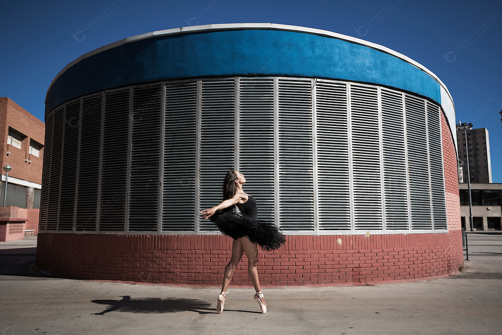Young ballerina dancing in the city